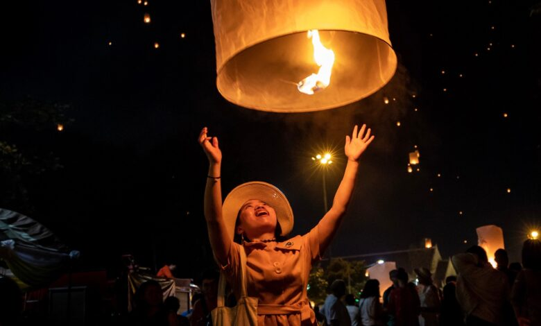 Image of woman release Chinese lantern