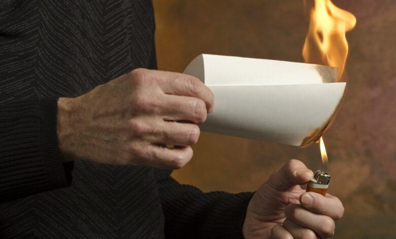 Image of man burning document
