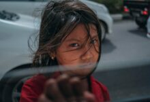 Image of girl standing next to open car window