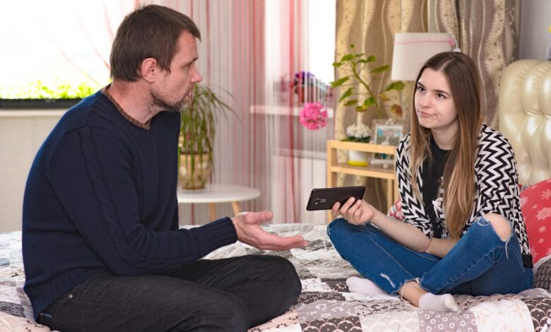 Image of a father and daughter having a discussion