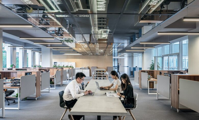 Image of employees in modern office