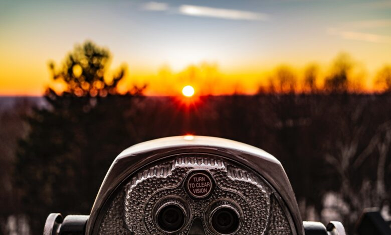 Binogulars looking at sunrise