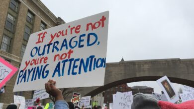 Image of protester holding sign