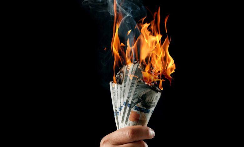 Image of money burning