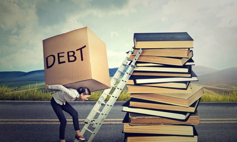 Image of student carrying heavy debt load