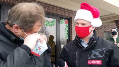 Image of man receiving secret Santa gift