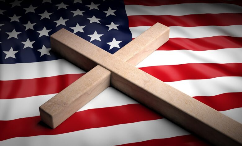 Picture of wooden cross on American flag
