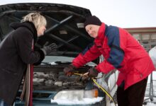 Picture of a man helping to start a woman's car