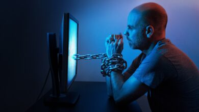 Image of man chained to a computer screen