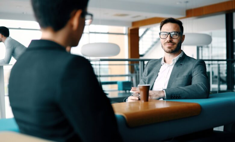 Picture of two men in casual conversation