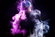 Picutre of man disappearing behind cloud of smoke