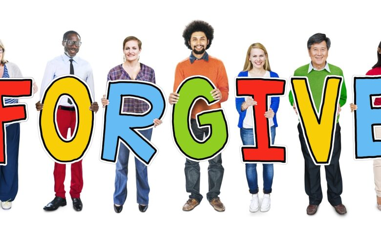 Image of group of people spelling the word FORGIVE