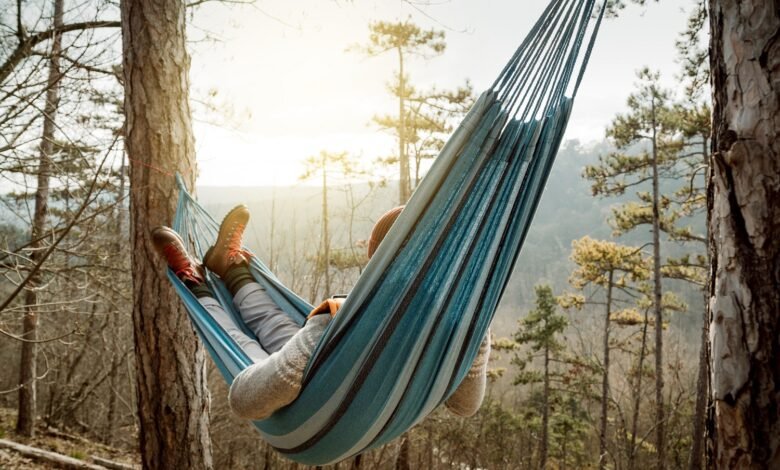 Image of a man resting in a hammock