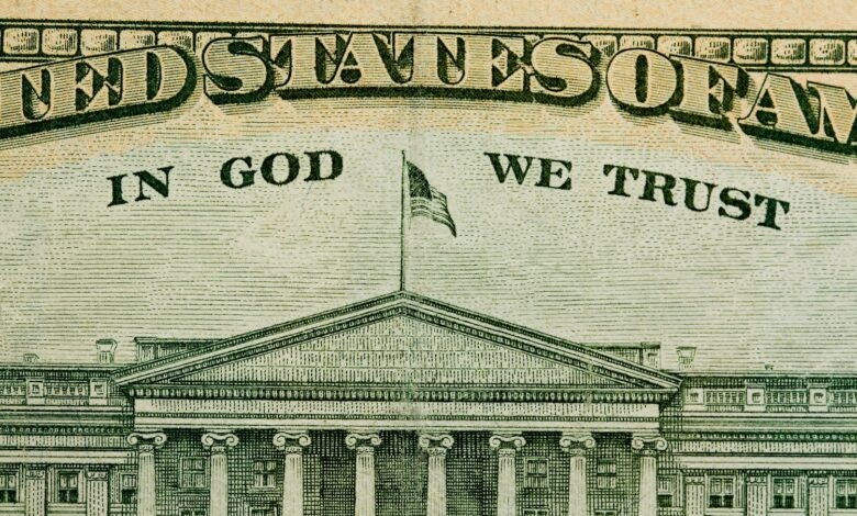 Paper money with words In God We Trust