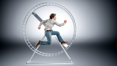 Image of a man caught in a hamster wheel
