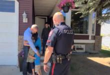 Image of Police arresting pastor Tim Stevens