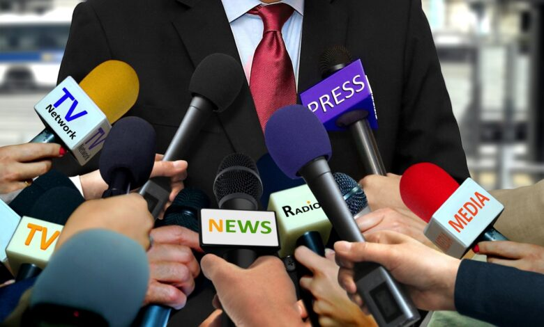 Image of microphones at a press conference