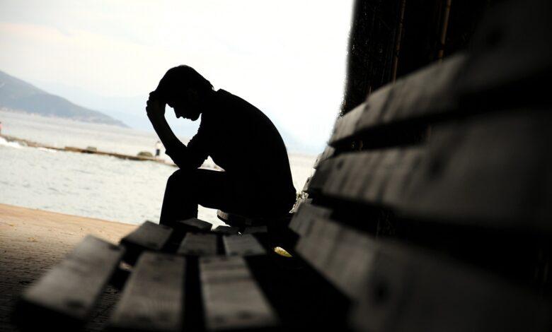 Image of man praying by himself