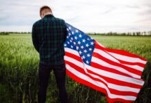 Image of a grateful man holding an American flag