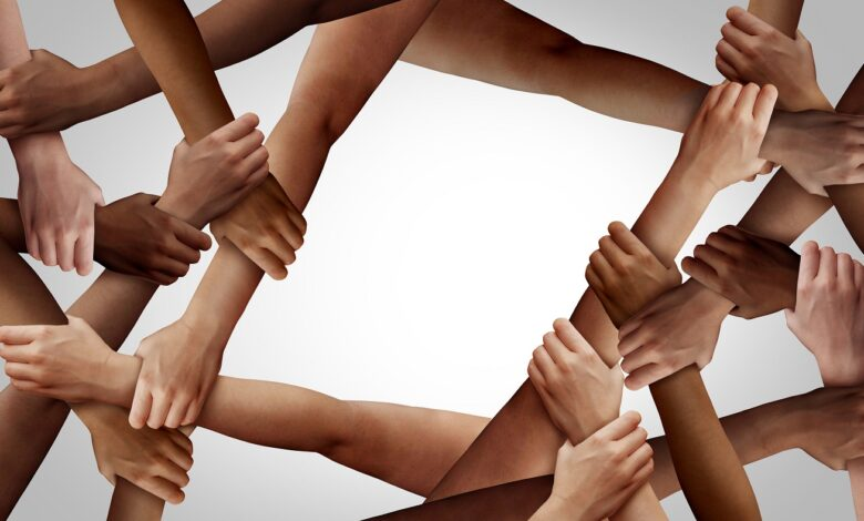 Image of people forming a web with hands and arms.