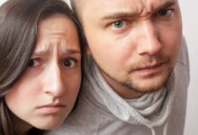 Image of a skeptical man and woman