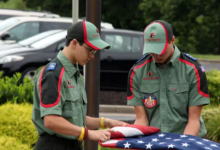 Image of Trail Life members folding a flag