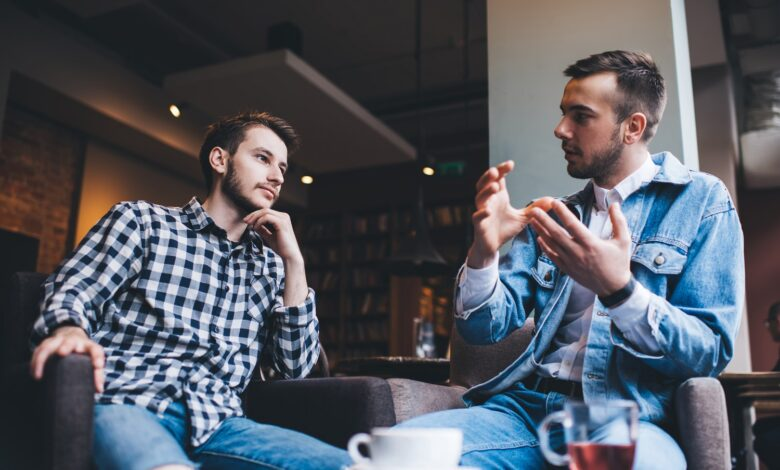 Image of two men engaged in serious discussion.